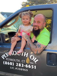 Kevin and Rae in a Plymouth Oil Truck